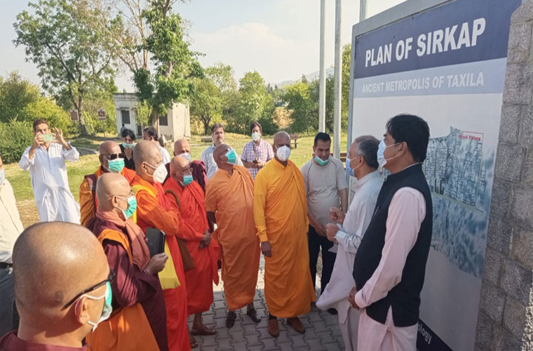 Sri Lankan Buddhist monks visit an archaeological site Sirkap in Taxila
